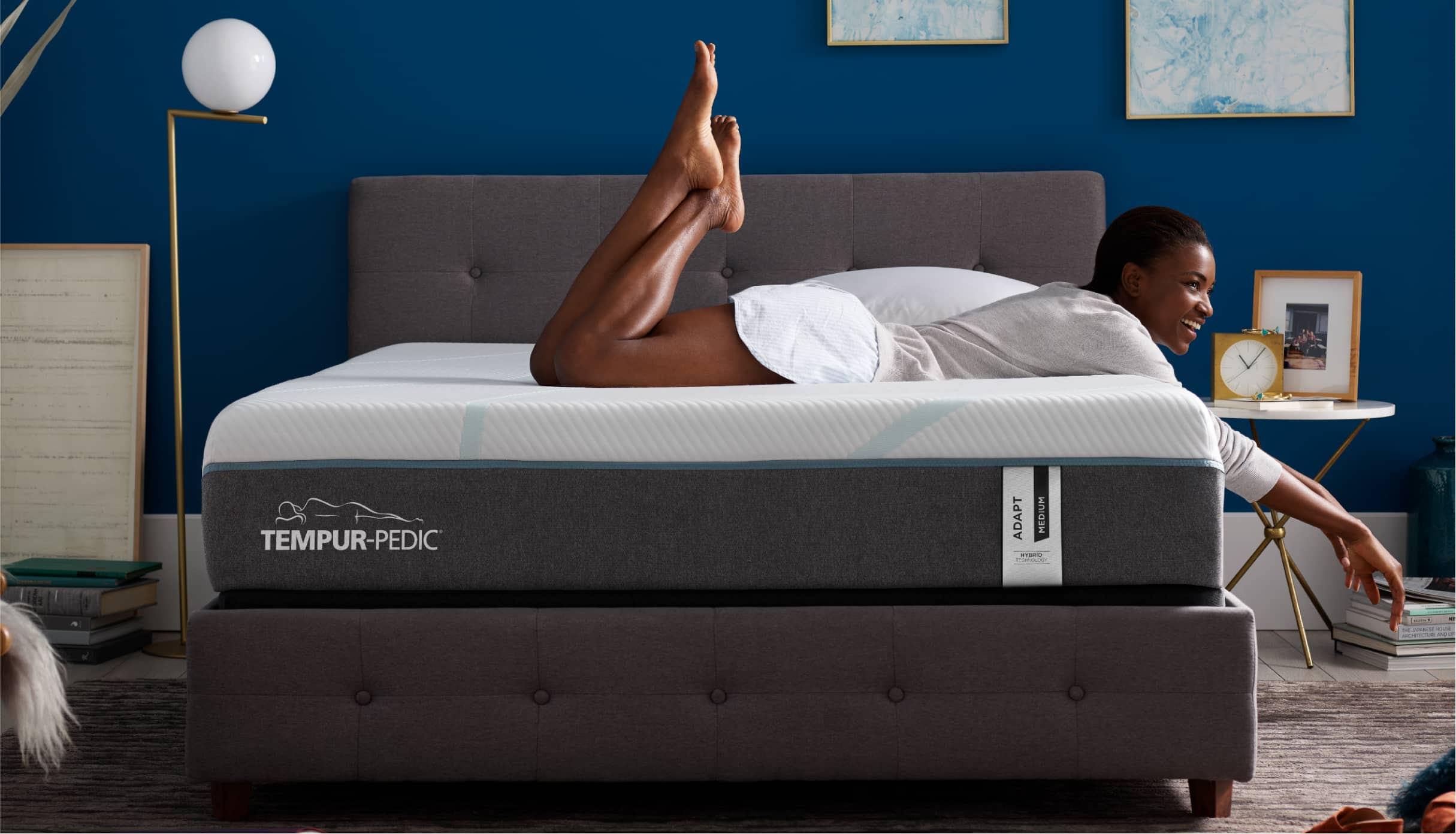 Woman laying on a Tempur-Pedic® mattress.